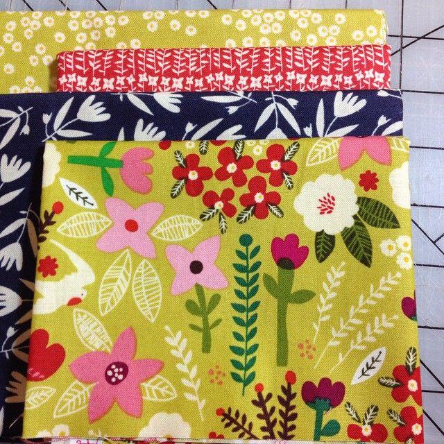 """#CarolynGavin #OrganicCotton #fatquarter cuts $2.75 each @doestreetfabrics #yellowfabric #redfabric #bluefabric"" Photo taken by @doestreetfabrics on Instagram, pinned via the InstaPin iOS App! http://www.instapinapp.com (02/02/2015)"