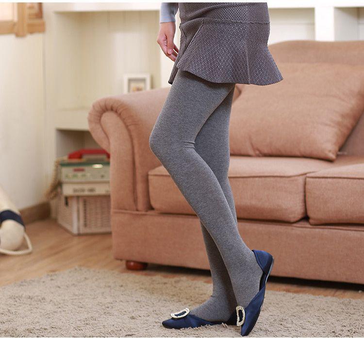 Frauen tragen Strumpfhosen Stiefel Trikots
