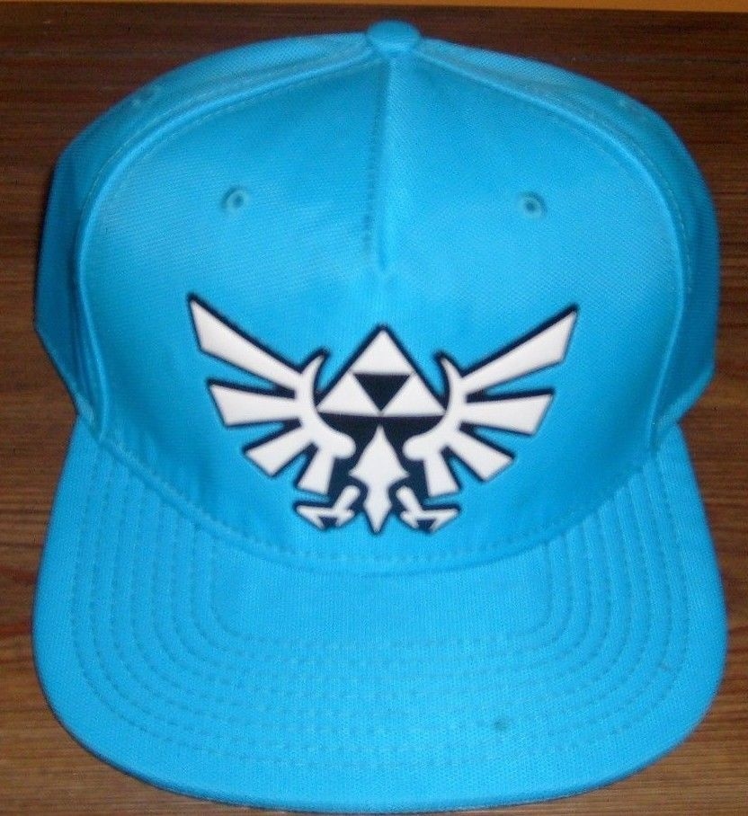 41dc3c3f54a9b LEGEND OF ZELDA LOGO WHITE ON BLUE FLAT BILL ORIGINAL SNAPBACK HAT NINTENDO  NEW  Nintendo  BaseballCaptrucker