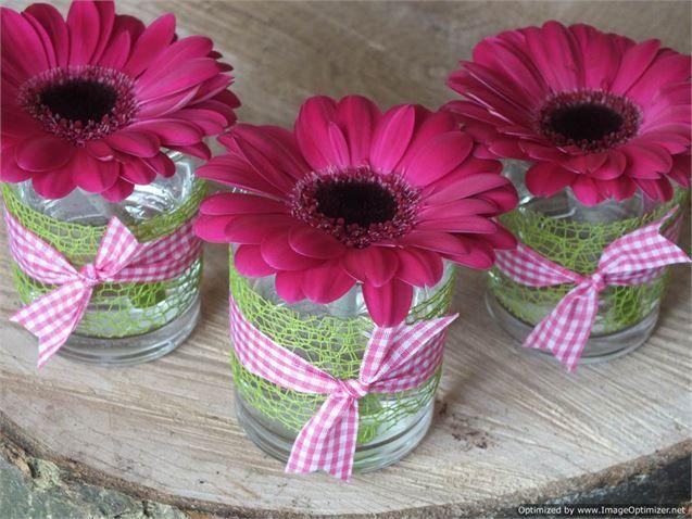 Hot pink germinis in glass votives - bloom bloom