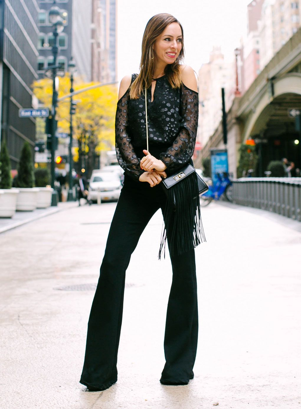 4253dc0d80886b Sydne Style - Los Angeles fashion blogger Sydne Summer shows how to wear  flared pants.