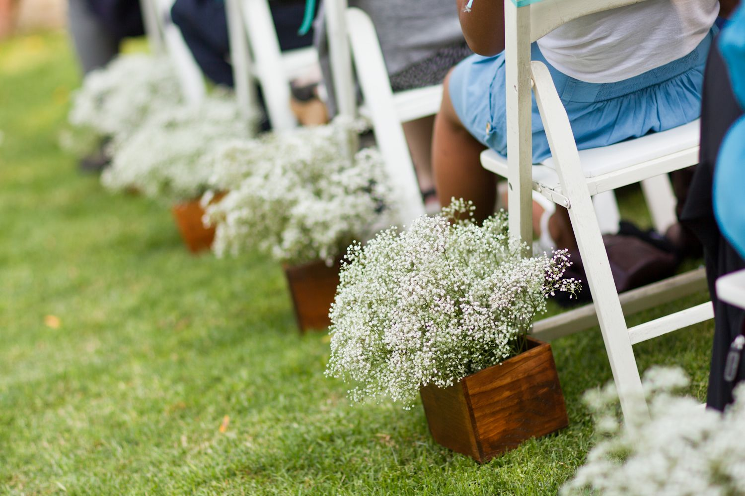 aisle flowers will repurpose as centerpieces wrap lace around
