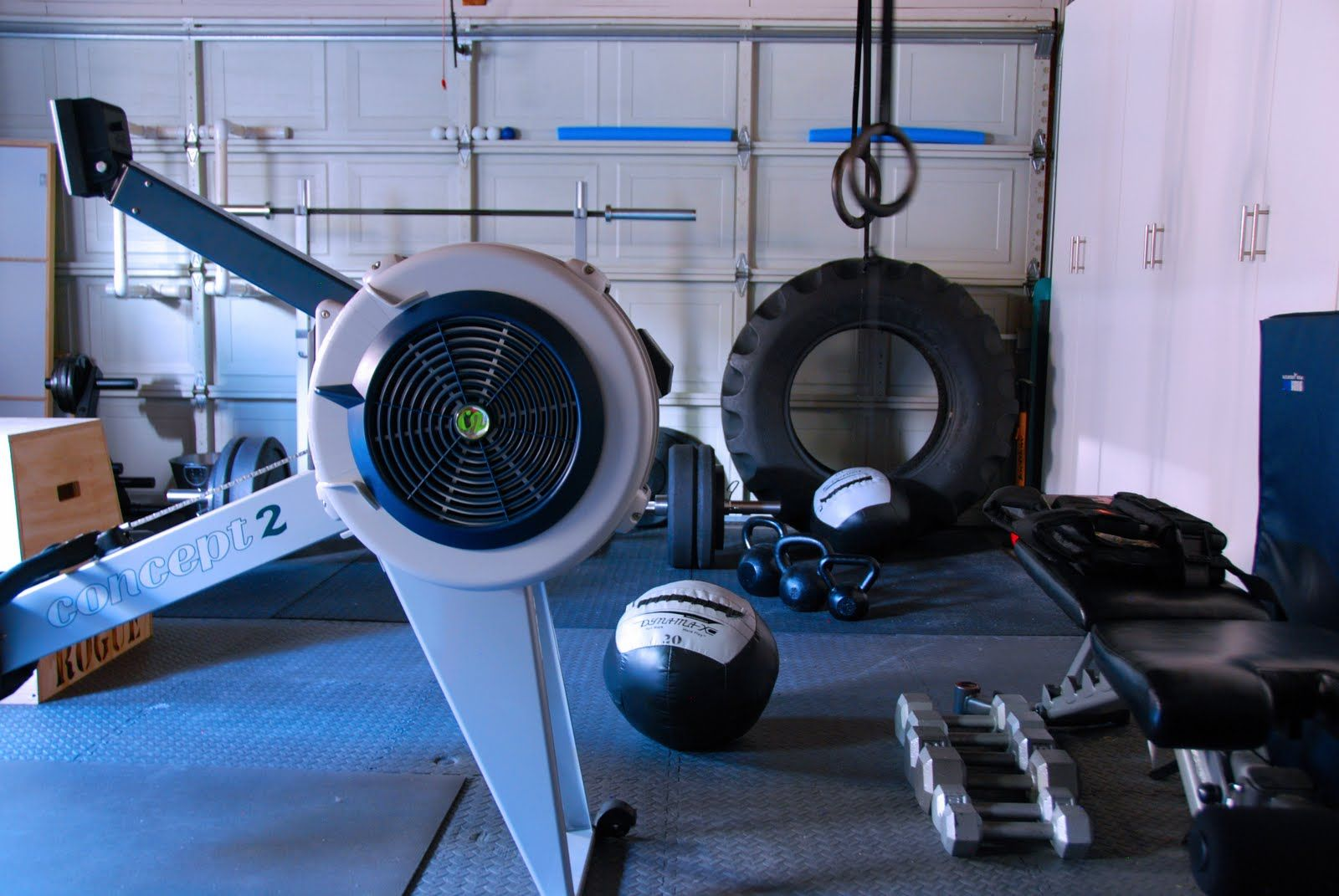 Concept rower tractor tire kettlebells dumbbells