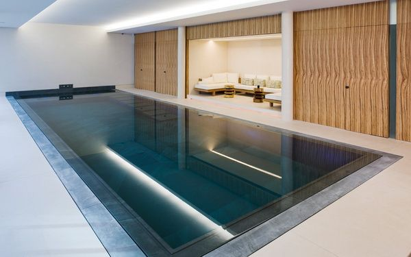 Uncluttered luxury with a pool contemporary london home for Pool design london