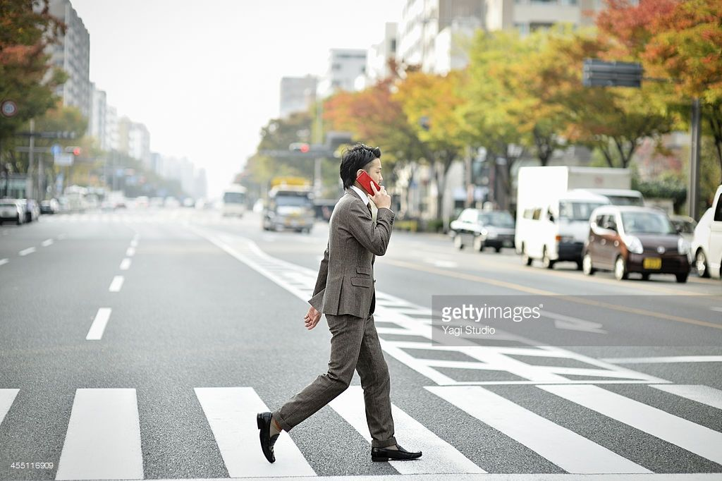 Well-dressed,Suit, Business,Japan,Kyoto,Man across the pedestrian crossing