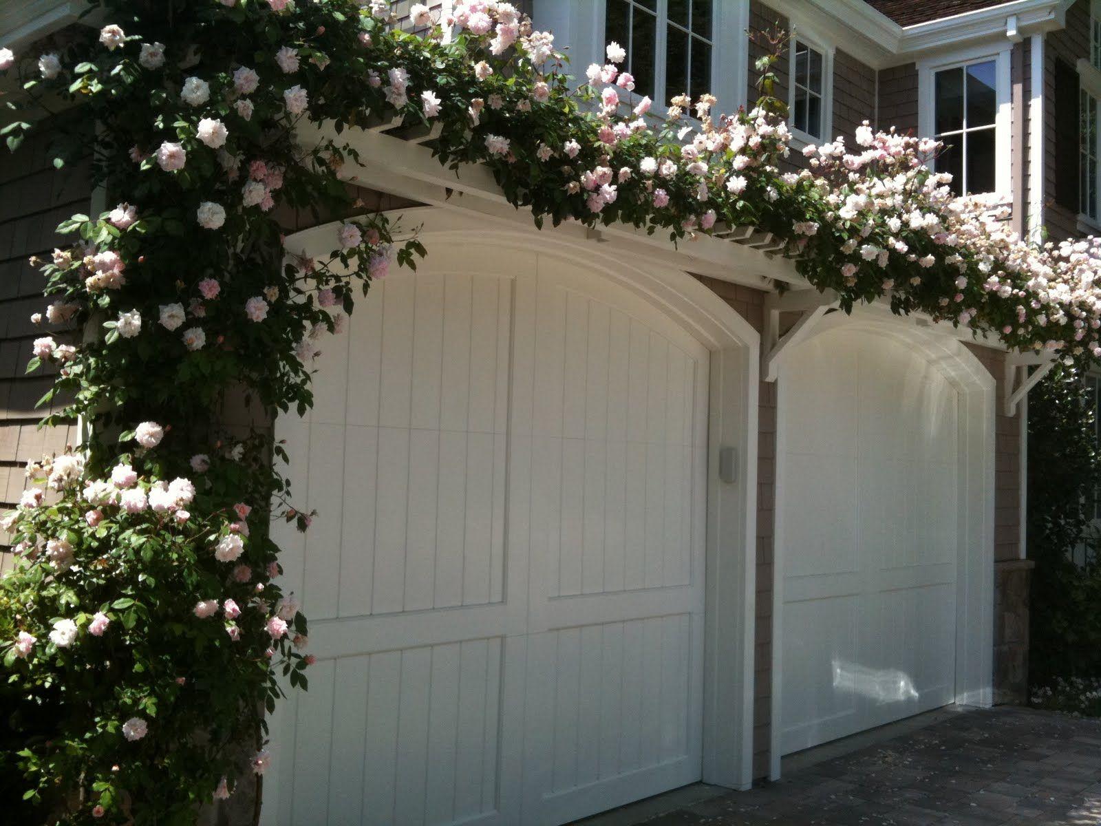 Trellis Above Garage Door Planted With Pink Climbing Roses