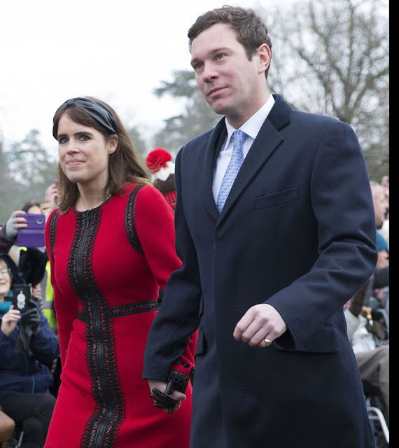 b0b51768365f Princess Eugenie opted for a more brighter outfit in a red dress striped  with an elaborate black pattern as she clutched her husband Jack  Brooksbank's hand ...