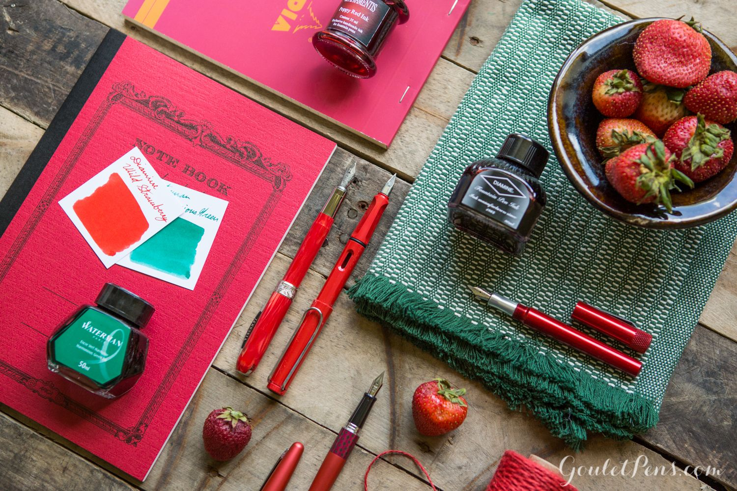 Look at this tasty arrangement of strawberry themed fountain pens, notebooks, and ink!