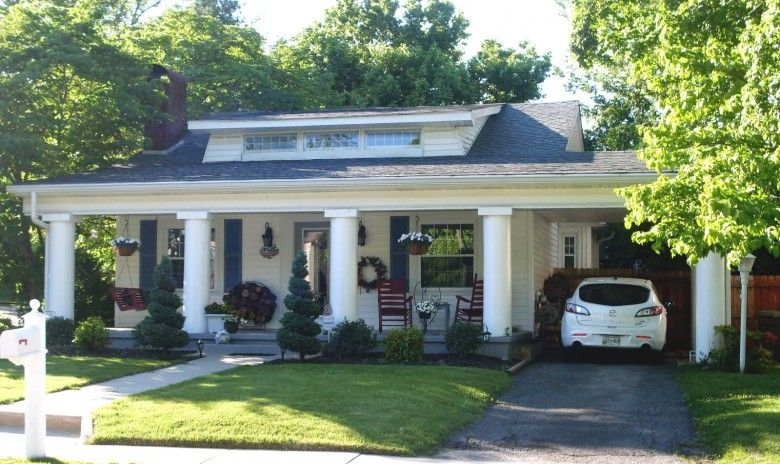 Astonishing Bungalow House Design With Small Carport And Large
