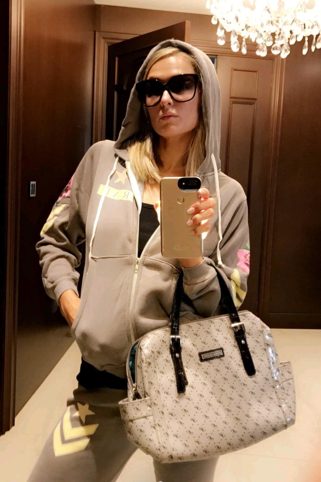 aad512538b7 Paris Hilton wearing Paris Hilton Star-P Boston Bag, Dita Paradis  Sunglasses in Black, Wildfox Couture Rad Regan Zip Hoodie and Wildfox  Couture Rad Fame ...