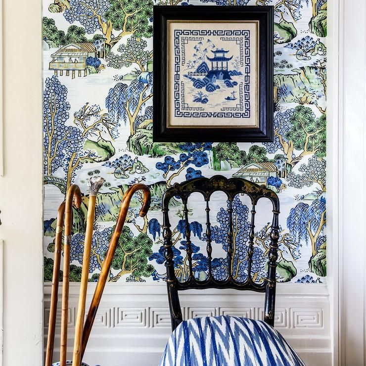 A wall covered in Thibaut Asian Scenic Wallpaper lined
