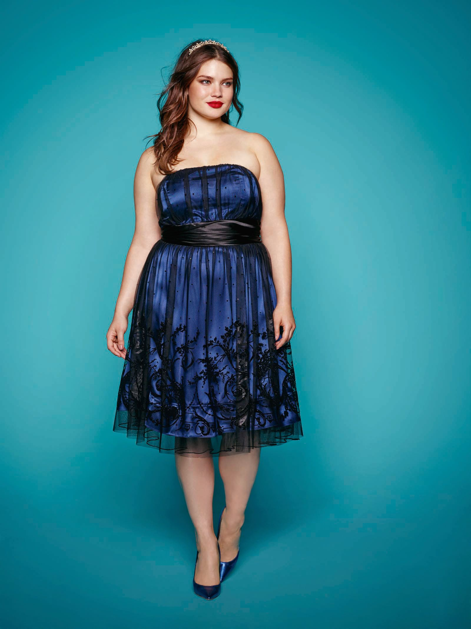 83c8ff6b35e7c Plus size model Tara Lynn wearing the beautiful midnight blue crinoline  dress. Available at Addition Elle.