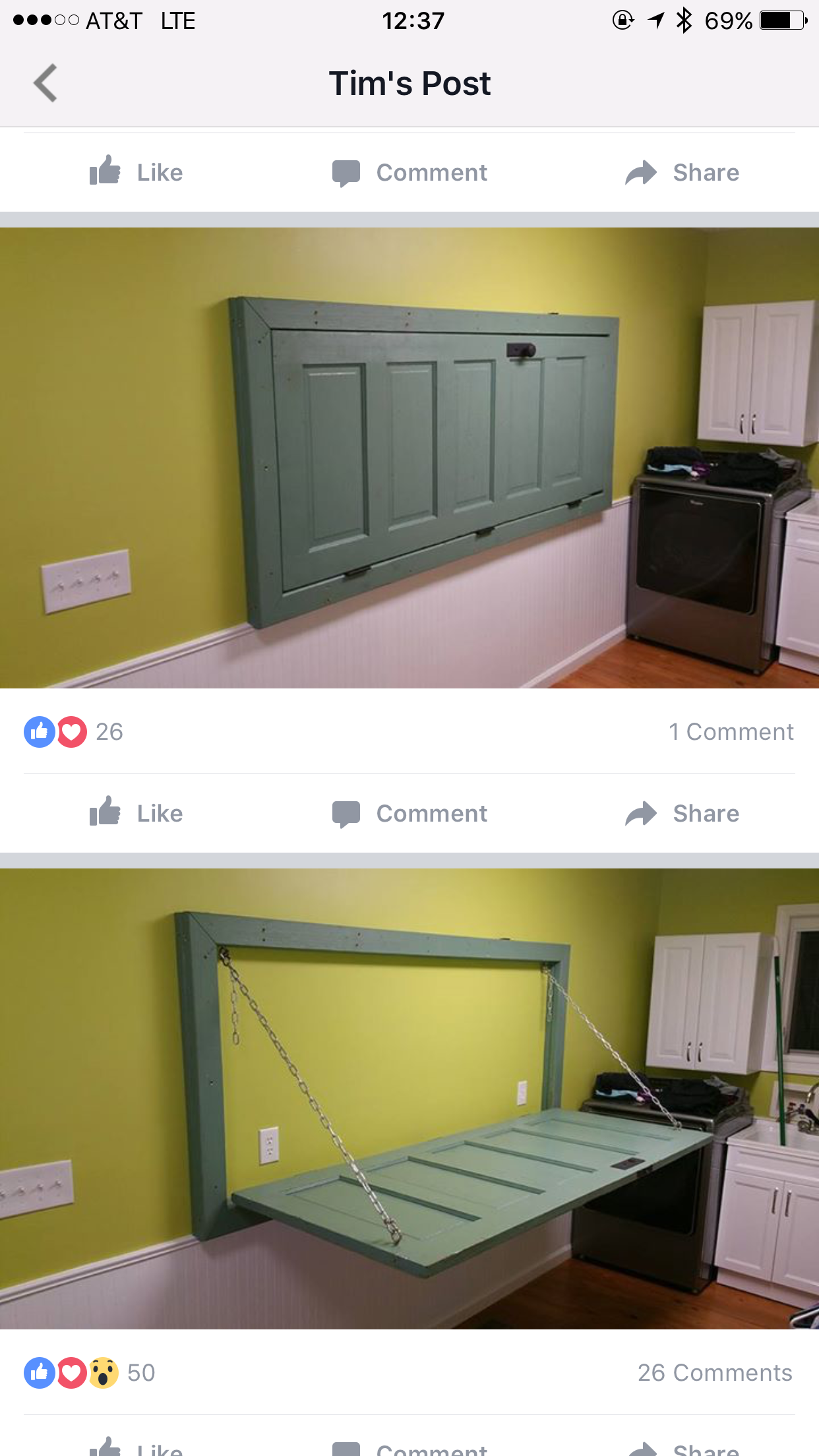 Folding table made out of old wooden door hung on the wall
