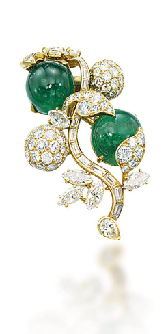 AN EMERALD AND DIAMOND BROOCH, MOUNTED BY CARTIER Designed as a spray of stylized flowers, with baguette-cut diamond stem, marquise-cut and pavé-set diamond leaves and flowers, to the two cabochon emerald accents, 4.8 cm, with French assay mark for gold, in black velvet Cartier pouch With maker's mark and signed Monture Cartier, no. 7245
