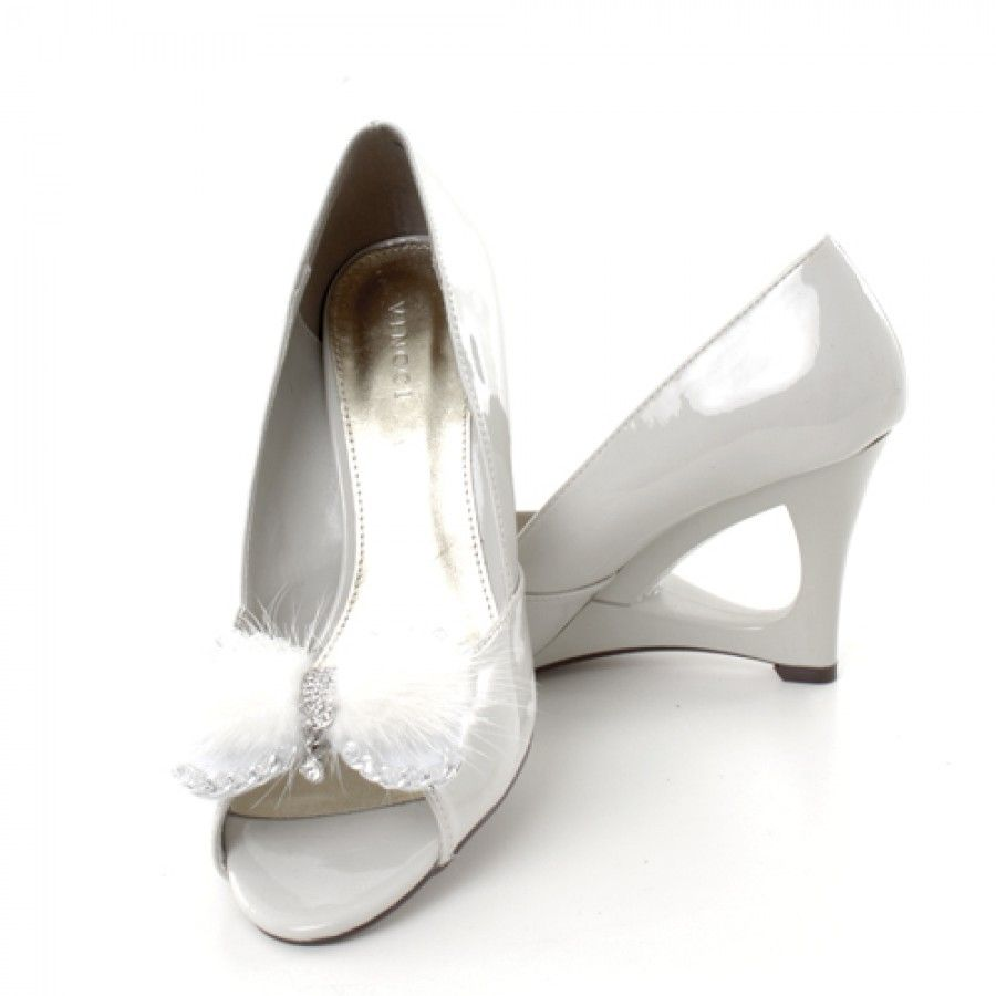 A diaphanous bow of mink fur creates a snowy, ethereal feel in classic shoe clips fit for a trend-setting princess. Silver cable chain defines the edges of the shoe clip, while a dazzling matrix of crystals at the center anchors a single sweet crystalline charm.