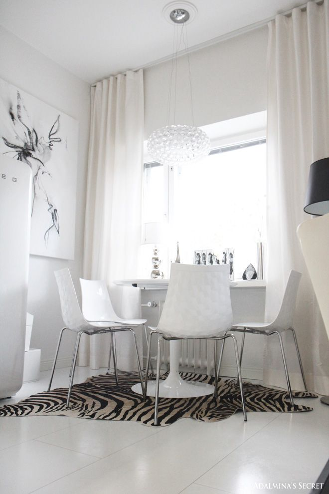 White dining area with zebra rug - Adalmina's Secret