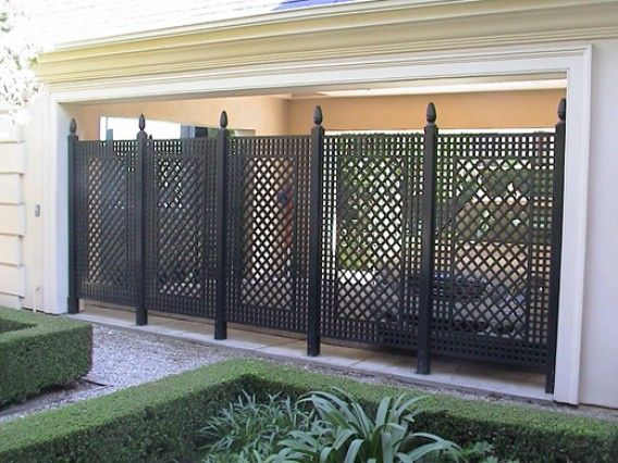Love this outdoor iron privacy screen outdoors for Lattice screen fence