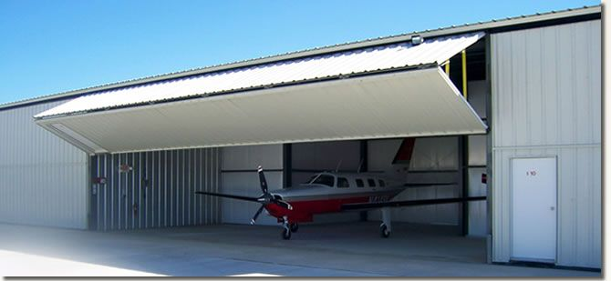 hangar doors | Bifold door on an aircraft hangar & hangar doors | Bifold door on an aircraft hangar | Hangar doors ...