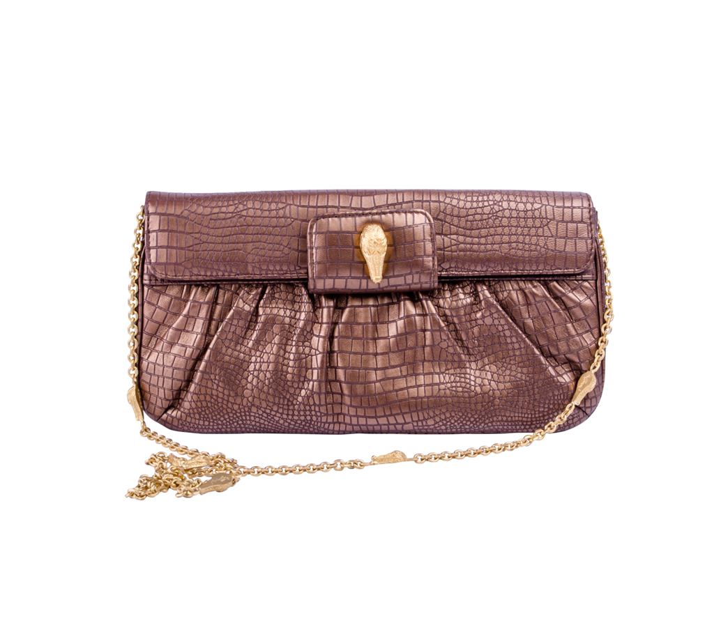 Krista Clutch  Cute and just a little bit fancy, the Krista Clutch is sleek and smooth with soft features and rounded edges. The crocodile printed outer fabric and delicate gold chain that can be pulled out for an over shoulder strap or tucked away for a luxury clutch purse.