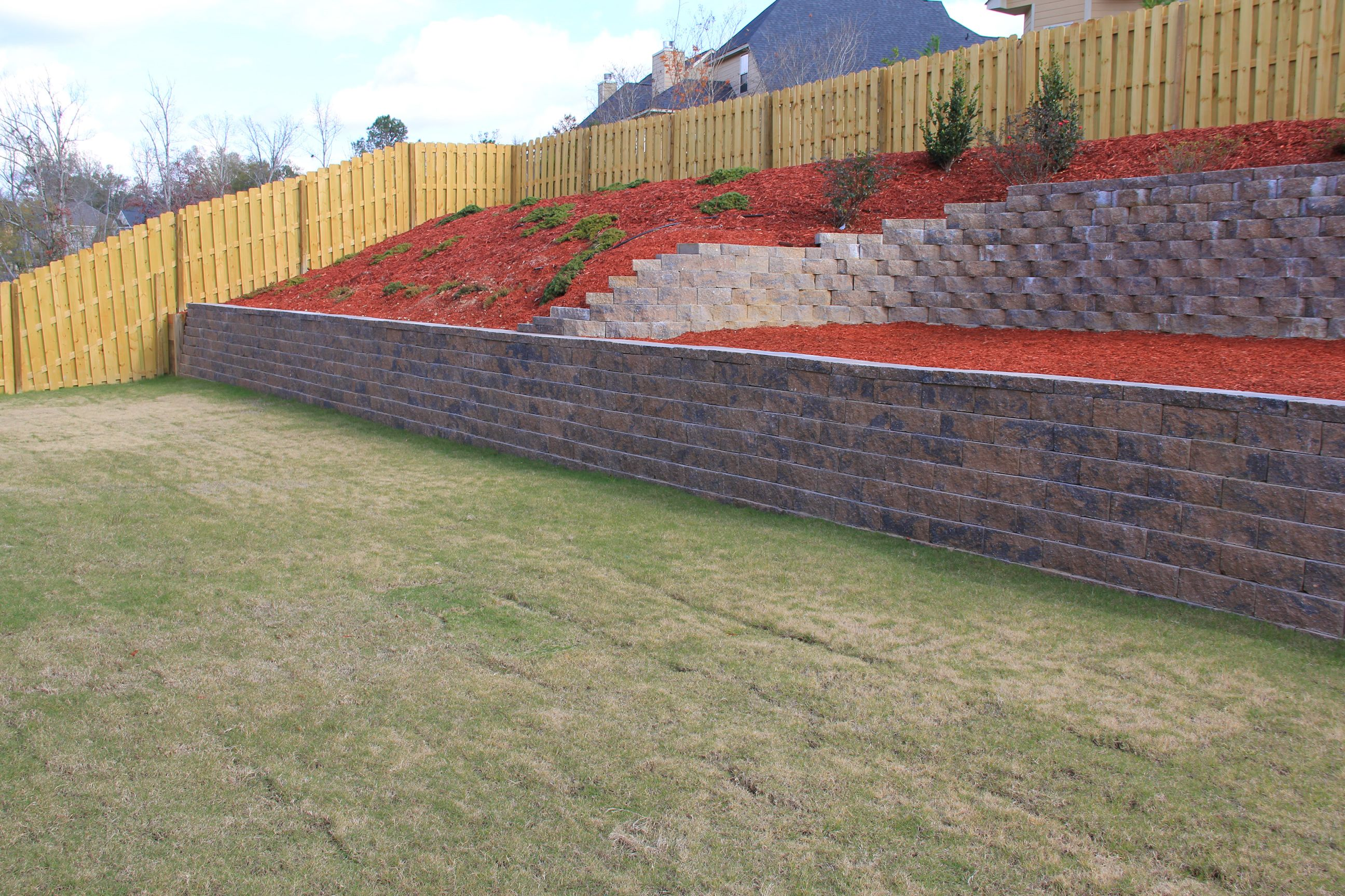 Retaining Wall Landscaping Lawn Care And Retaining Walls Sloped Backyard Landscaping Sloped Backyard Backyard Remodel
