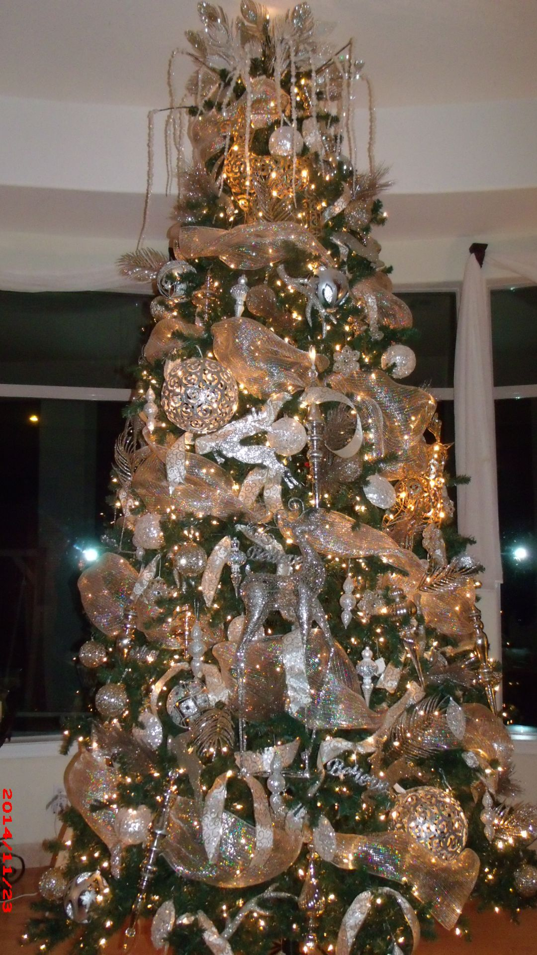 my fancy 12 ft Christmas tree! Decorated by Mindy ...