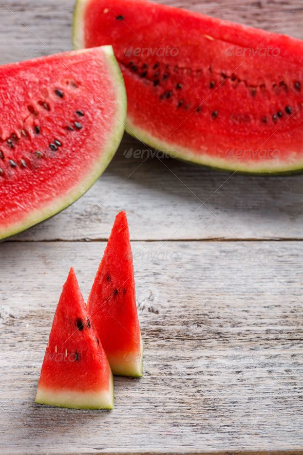 Slices of watermelon ...  color, cut, dessert, diet, eat, food, fresh, freshness, fruit, green, healthy, juicy, melon, natural, nature, nutrition, object, organic, part, peel, piece, pulp, red, ripe, round, section, seeds, slice, snack, striped, summer, sweet, tasty, water, watermelon, wooden