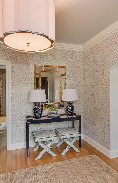 foyer features walls clad in Schumacher Celerie