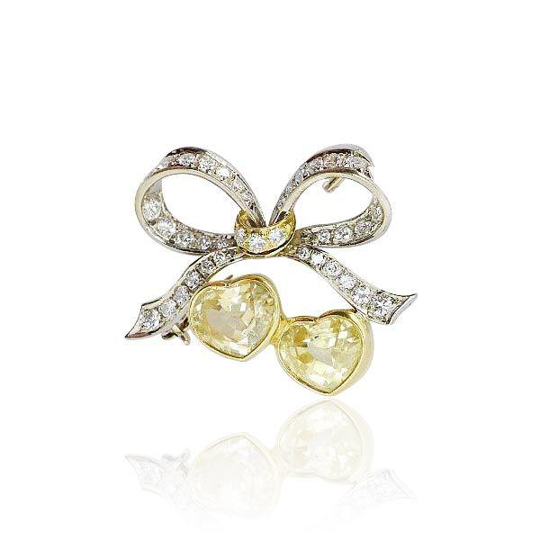 Brooch with yellow Sapphire  Schleifen Brosche mit 1,466ct Diamanten und 4,609ct gelben Saphiren in Herzform