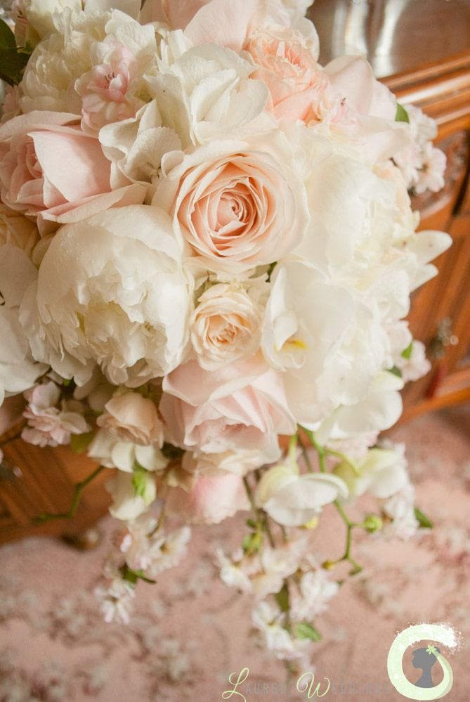 Teardrop bouquet of roses, peonies, blossom and orchids ...
