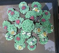 Cupcakes with dragonflies, bees, and ladybugs
