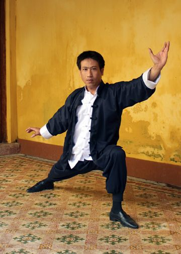 a54331ec2 This is our tailor wearing the Bruce Lee style outfit by Tai Chi Tranquility