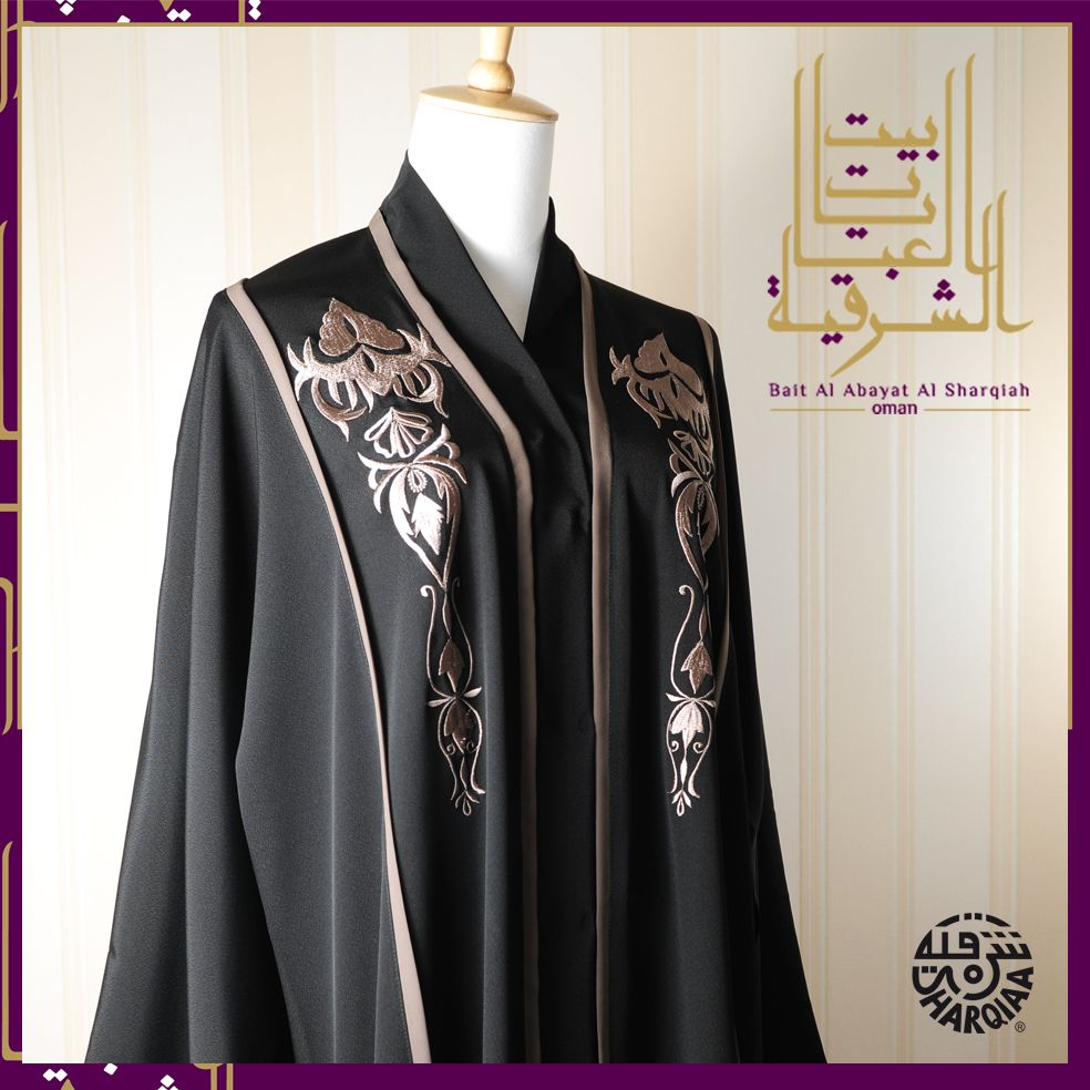 """What makes is Chic is the design at the chest and high neck .. By """"Sharqiaa"""""""