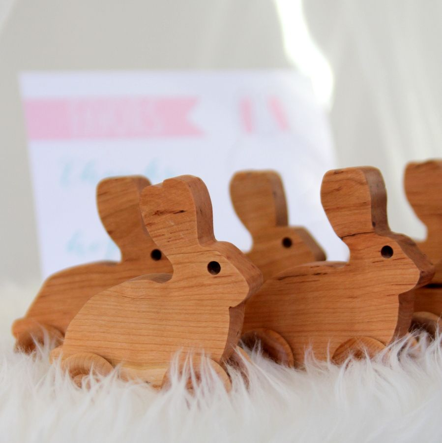 snow bunny birthday party favors rolling wooden rabbits by