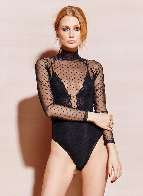 bce308dc48 Fleur du Mal sheer tulle dot bodysuit in black. Turtleneck long sleeve  bodysuit with back zipper closure   snap closure.
