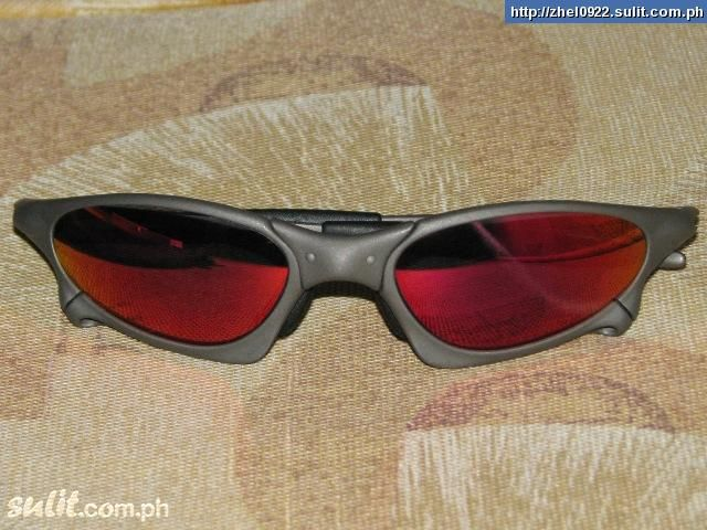 Oakley Penny X-Metal frames with dark ruby lens sunglasses.