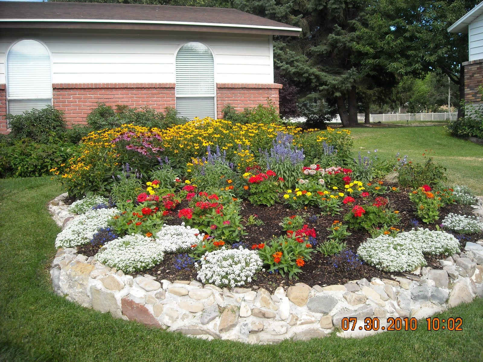 Flower beds this is how the flower bed looks after for Front yard flower bed designs