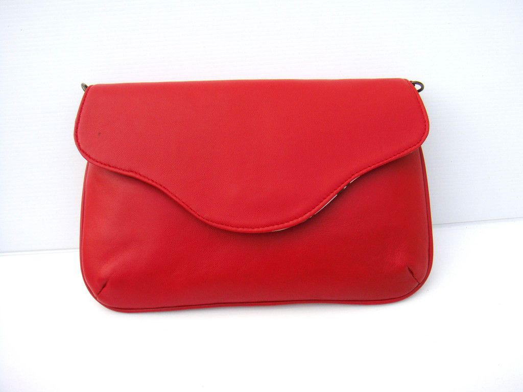 http://www.afday.com/collections/bags/products/red-sling-bag  Rs 1800