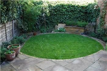 circular lawn combined with diagonal paving expands impression of a small gardens size