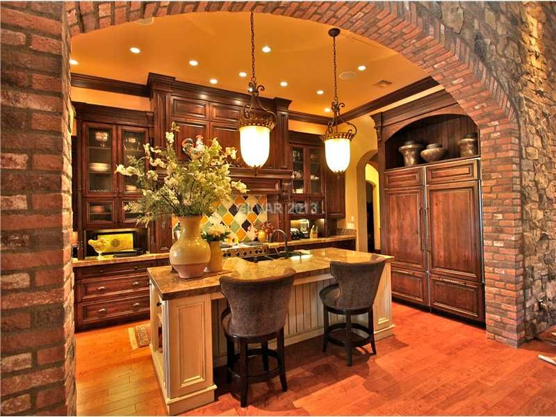 tuscan kitchen with pendant lights and stone arch the style lighting is great in