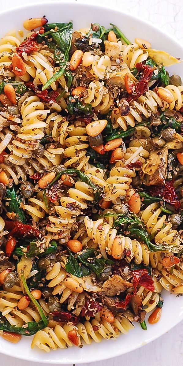 Italian Pasta with Spinach, Artichokes, Sun-Dried Tomatoes, Capers, Garlic, and Pine Nuts!  This me