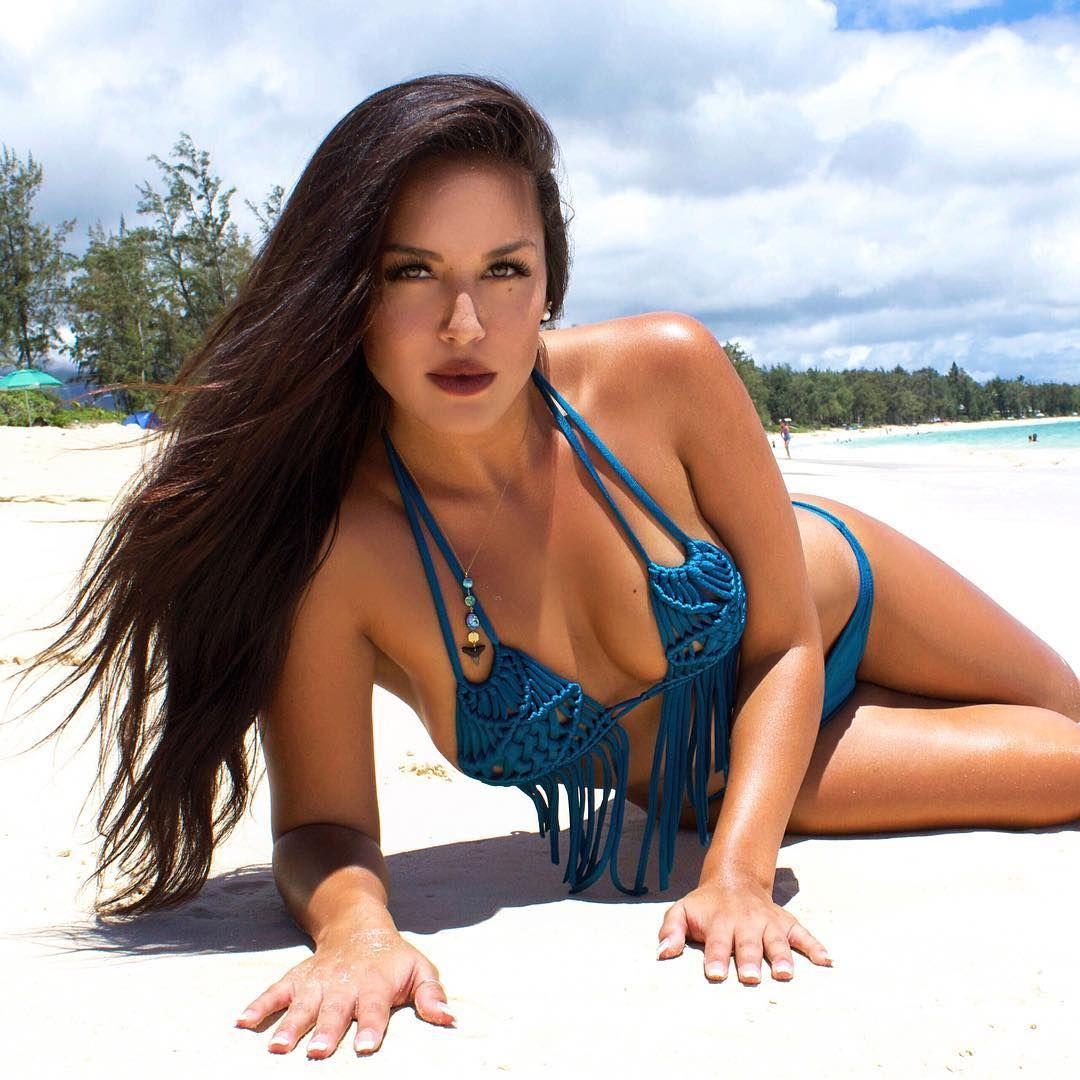 sexy brunette model savannah jerson on the beach in a blue bikini