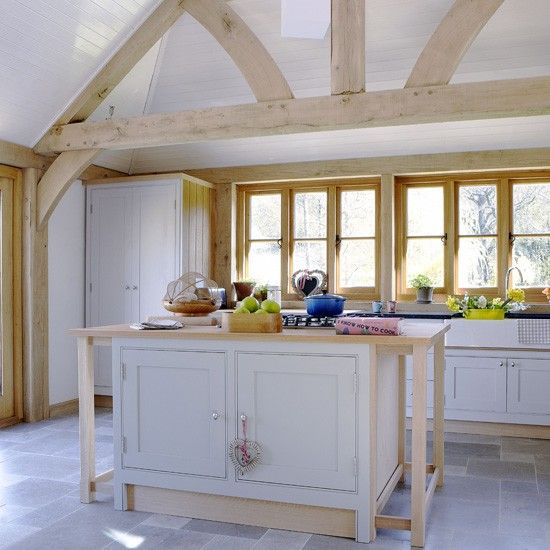 Captivating Light Country Kitchen A Large Central Island Works As A Focal Point For  This Large Kitchen