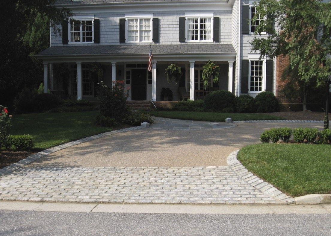 Cobblestone apron, played cobblestone band, exposed aggregate driveway. A  PLANTERS GARDEN Design.