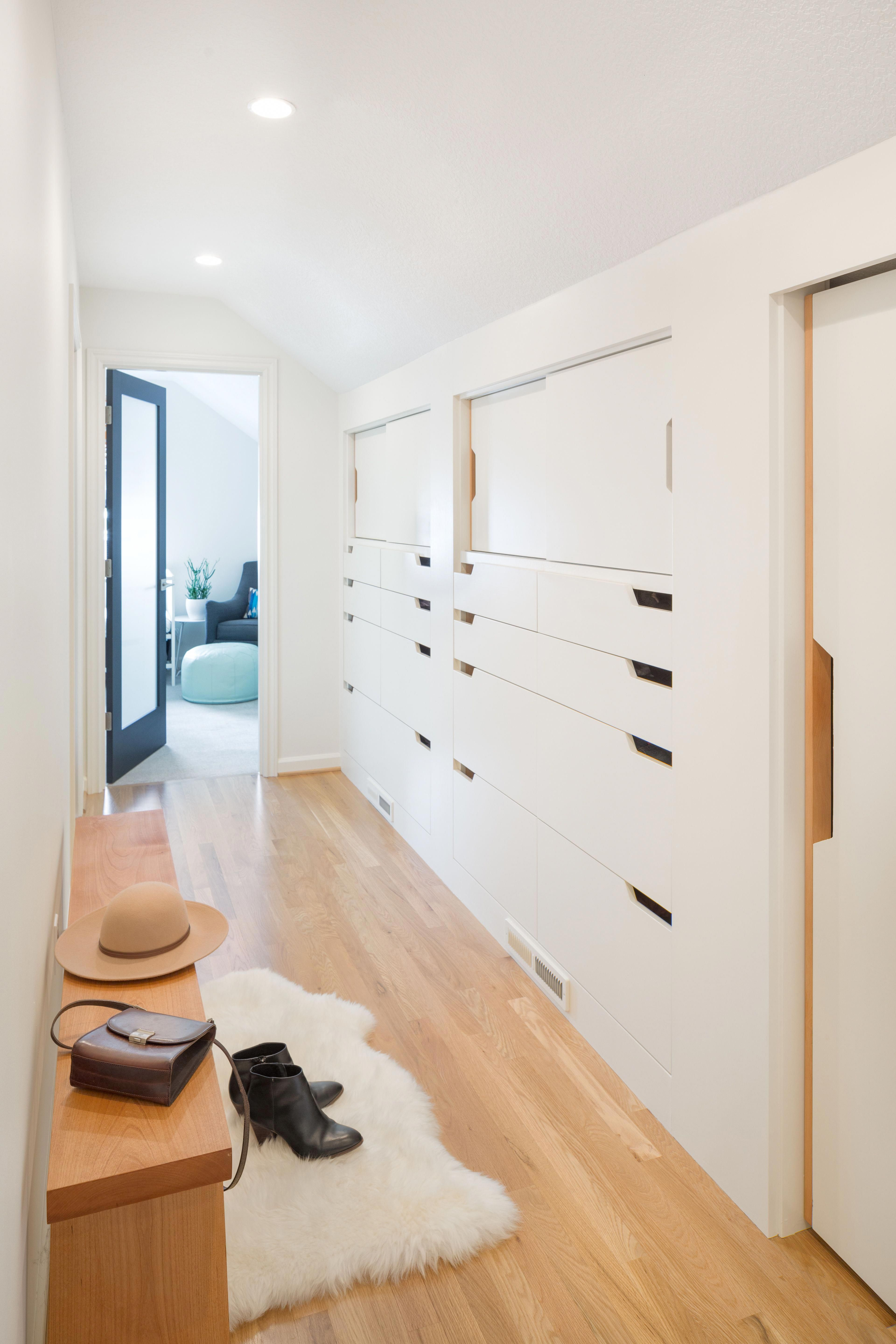 The bright white hallway adds a lot of storage and still feels spacious hallwayideas