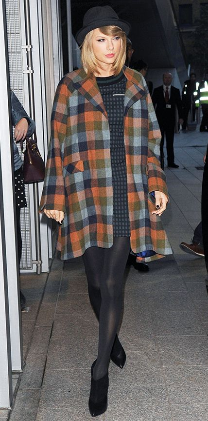 Taylor Swift wearing a Novis swing coat over Timo Weiland separates, with a Rag & Bone hat, black tights, and Jimmy Choo ankle-boots.