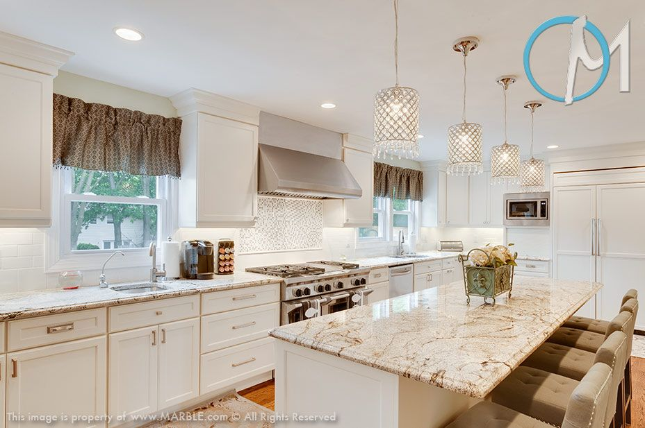 Golden Eagle Granite With Off White Kitchen Cabinets