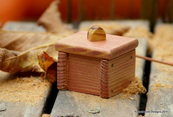 A Very Small But Unique Wooden Gift Box Featuring A Nub Of