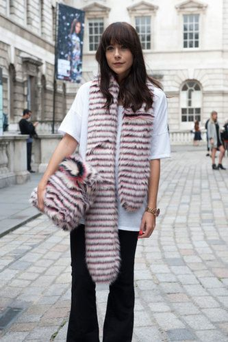 A fur clutch is striking enough as is, but when you've got a matching scarf, all you need are jeans and a t-shirt.                  Source: IMAXTREE / Alessia Gammarota