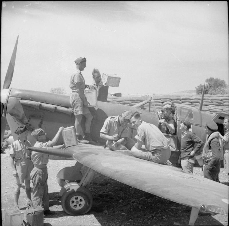 Army and RAF personnel refuelling and a Spitfire Mk V, Malta, 17 June 1942.