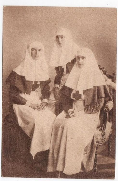 A postcard of Grand Duchesses Olga and Tatiana and Empress Alexandra in the uniforms of Sisters of Mercy: 1915